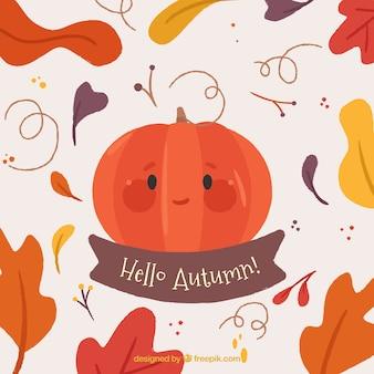 Abóbora Smiley e folhas de outono coloridas