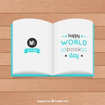 Abra o livro em uma mesa de madeira