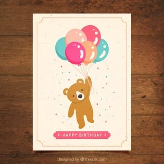 Adorável urso com cartão de aniversário balões