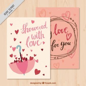Amor cartões com guarda-chuva e corações