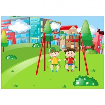Arquitectura da cidade com as crianças em um balanço