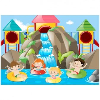 As crianças se divertindo na parque aquático