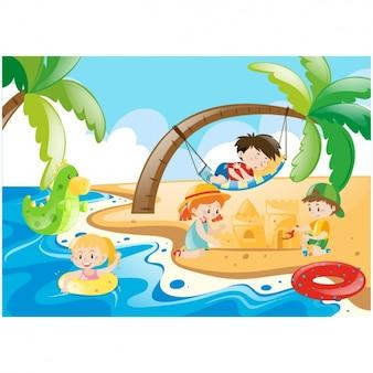 As crianças se divertindo na praia