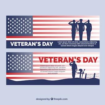 Bandeiras com soldados dos Estados Unidos para o dia de veteranos