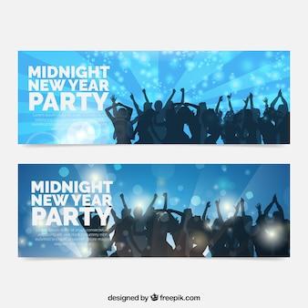Bandeiras do ano novo com silhuetas de dança