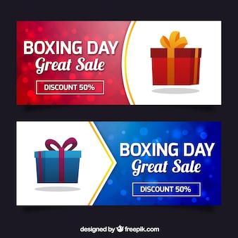 Banners Boxing Day com presentes e efeito bokeh