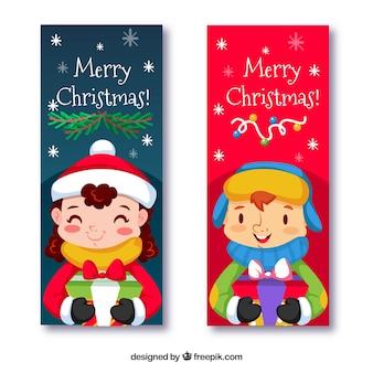 Banners de crianças bonitas que comemoram o Natal