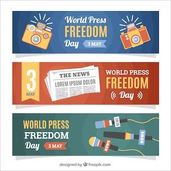 Banners de dia da liberdade de imprensa mundial com microfones e câmeras