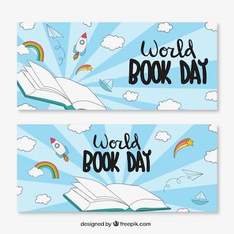 Banners desenhados à mão com nuvens e foguetes para o dia do livro do mundo