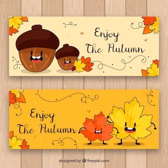 Banners divertidos do outono com a mão desenhada e as folhas