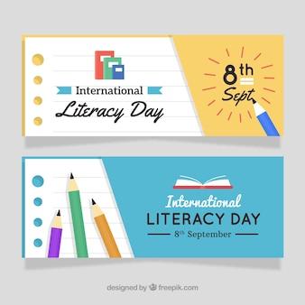 Banners do dia da alfabetização com lápis