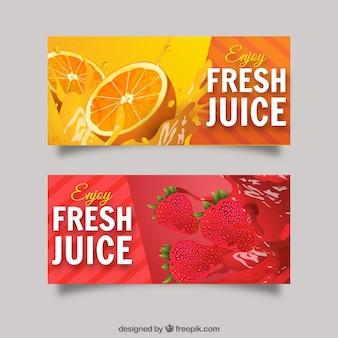 Banners realistas com sumos de laranja e morango