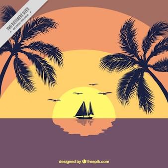 Barco à vela ao pôr do sol