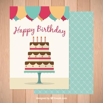 Belo cartão de aniversário com um bolo gigante