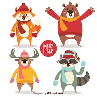 Bloco de quatro animais sorrindo com acessórios de inverno