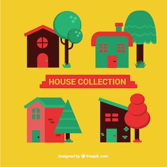 Bloco de quatro casas com árvores