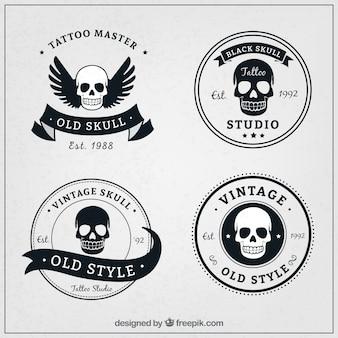 Bloco de quatro logotipos crânio no estilo retro