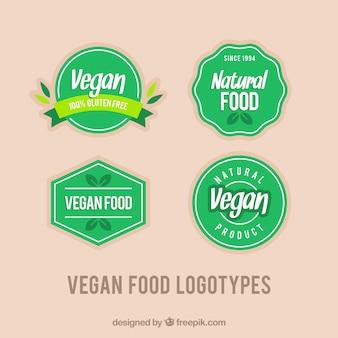 Bloco de quatro logotipos vegan do vintage verde