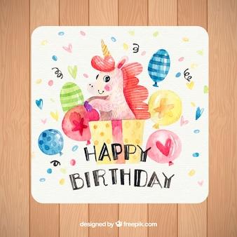 Bonito cartão de aniversário com balões de unicórnio e aquarela