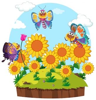 Borboletas que voam ao redor do jardim de flores