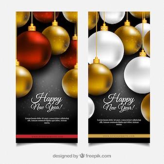 Brochuras de Ano Novo com bolas douradas