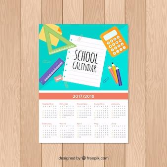 Calendário escolar plano com materiais