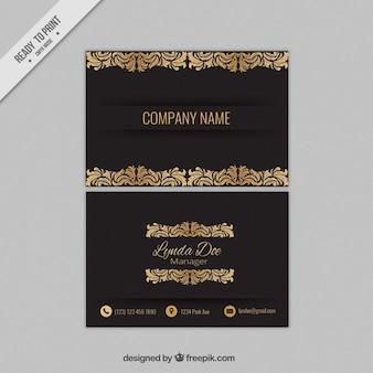 cartão corporativo preto com ornamentos de ouro