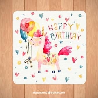 Cartão de aniversário com unicórnio e corações de aguarela