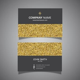 Cartão de visita com um design do brilho do ouro