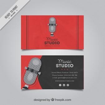 Cartão de visita com um microfone para um estúdio de música
