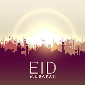 Cartão do eid mubarak com silhouttes da mesquita