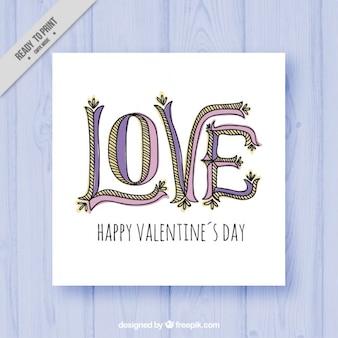 """Cartão do vintage com a palavra desenhado à mão """"amor"""""""