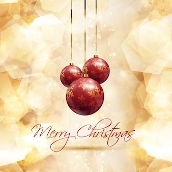 Cartão dourado do Natal com bolas vermelhas