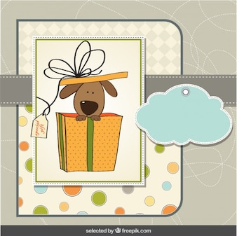 Cartão com cão bonito dentro da caixa de presente