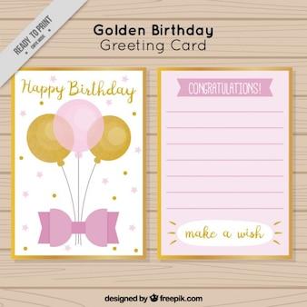 Cartão de aniversário com globos dourados