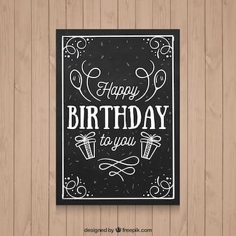 Cartão de aniversário preto com elementos desenhados mão
