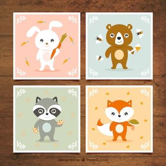 Cartões com animais agradáveis segurando alimentos
