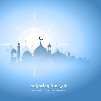 Céu azul ramadan kareem fundo com mesquita silhueta