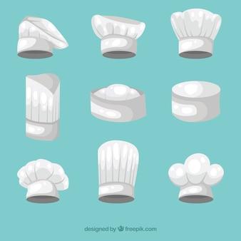 Chapéus do cozinheiro chefe da coleção em tons cinzentos