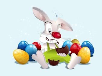 Coelho bonito com ovos coloridos