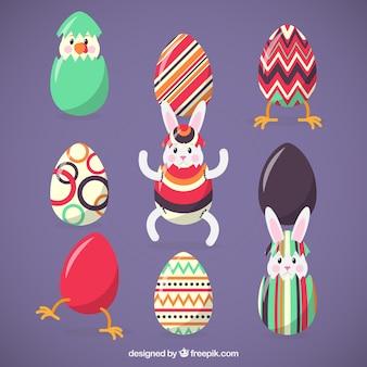 Coelhos engraçados e ovos de páscoa