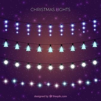 Coleção de luzes elegantes do Natal