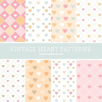 Coleção de padrões de corações em design plano