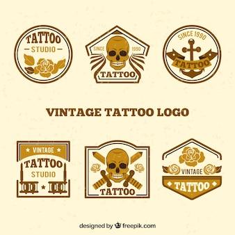 Coleção do logotipo vintage dourado da tatuagem