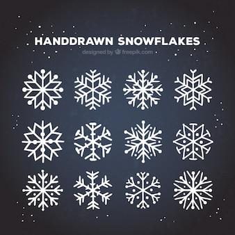 Coleção Flocos de neve no estilo desenhado mão