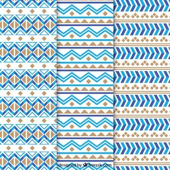 Coleção plana de padrões étnicos com formas azuis e marrons