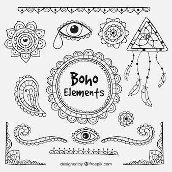 Conjunto de elementos tirados por mão étnica
