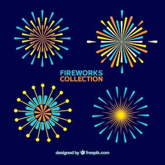 Conjunto de fogos de artifício em design plano