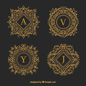 Conjunto de monogramas decorativos dourados