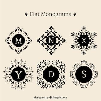 Conjunto de monogramas decorativos em design plano
